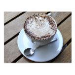 Taza de café con crema tarjeta postal