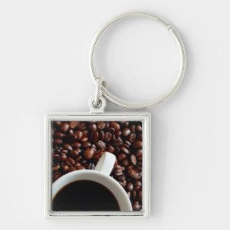 Taza de café con el café, fondo de los granos de llavero cuadrado plateado