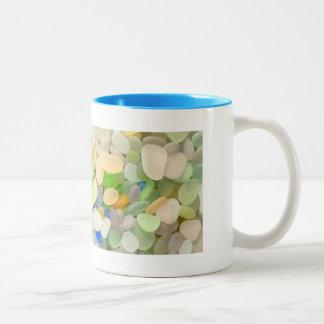 Taza de café de cristal del mar