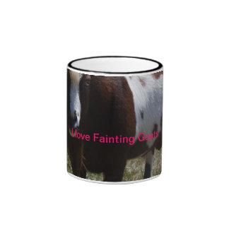 Taza de café de desfallecimiento de la cabra