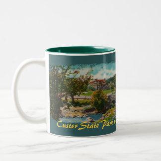 Taza de café de la casa de campo del juego del