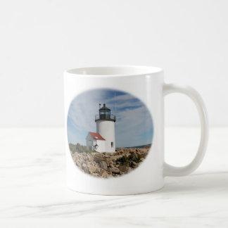 Taza de café de la luz de la isla de la cabra