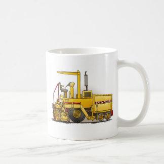 Taza de café de la máquina de pavimentación del