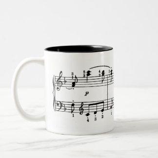 Taza de café de la música del piano