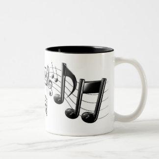 Taza de café de la nota de la música