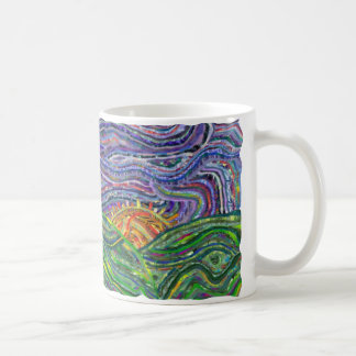Taza de café de la puesta del sol de la materia