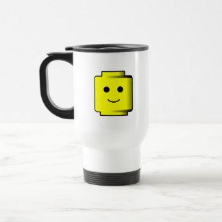 Taza de café de las cabezas de los bloques huecos