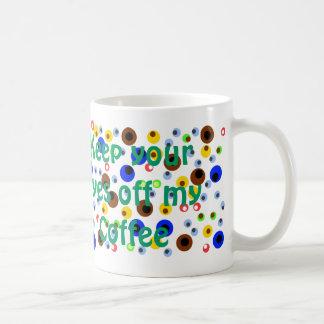 Taza de café de los globos del ojo