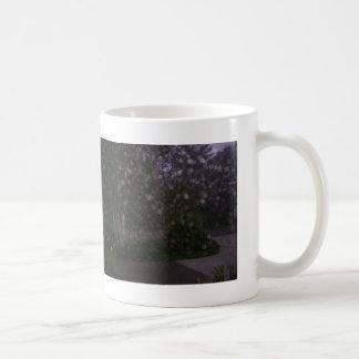 Taza de café de los orbes del alcohol