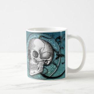 Taza de café del cráneo y del trullo de los remoli