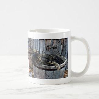 Taza de café del gato del país