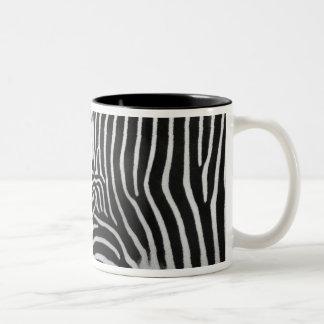 Taza de café del modelo de la raya de la cebra