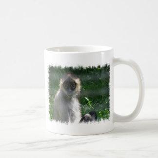 Taza de café del mono de araña