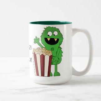 Taza de café del monstruo del adicto a las palomit