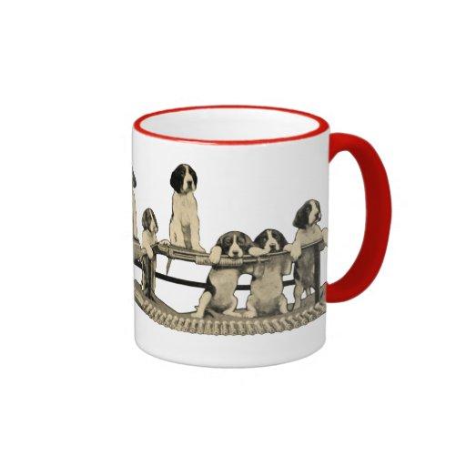 Taza de café del perrito del perro de las armas de