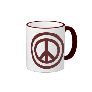 Taza de café del signo de la paz