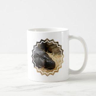 Taza de café enana del hipopótamo el dormir
