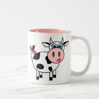 Taza de café feliz de la vaca del chica