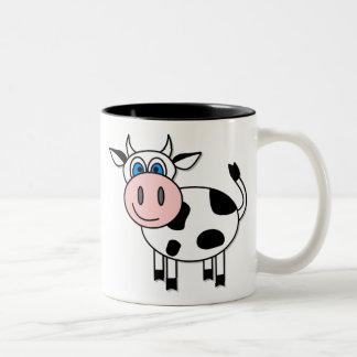Taza de café feliz de la vaca del muchacho