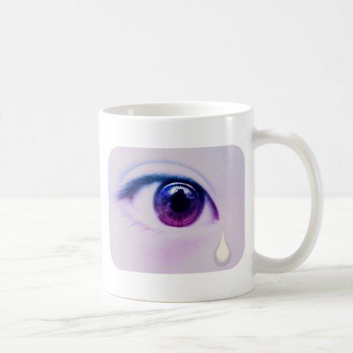 Taza de café gritadora de los rasgones