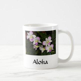Taza de café hawaiana de la orquídea