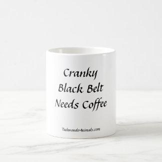 Taza de café irritable de la correa negra