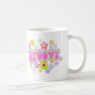 Taza de café maravillosa de la mariposa de las flo