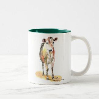 taza de café marrón de la vaca