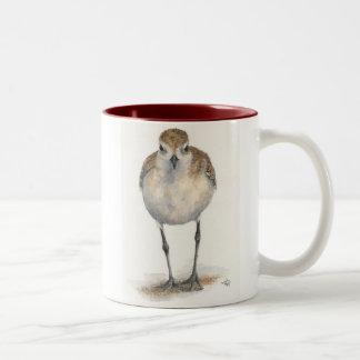 taza de café Negro-hinchada del chorlito