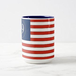 Taza de café patriótica del viejo modelo de la glo