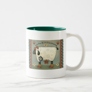 Taza de café remilgada de las ovejas del país
