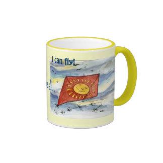 Taza de café roja de la cometa