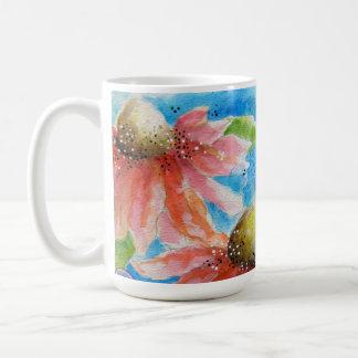 Taza de café rosada de la flor del cono
