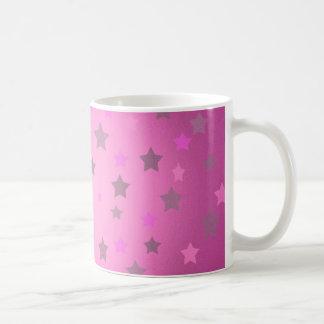 Taza de café rosada y gris del modelo de estrellas