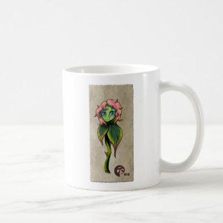 Taza de café triste de la flor