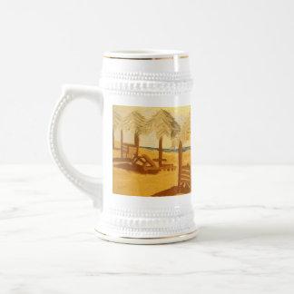 Taza de cerveza de la escena de la playa