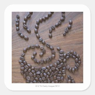 Taza de Coffe ilustrada usando los granos de café Pegatina Cuadrada
