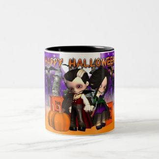 Taza de Halloween con dos niños del vampiro