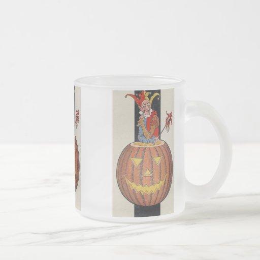 Taza de Halloween del bufón y de la calabaza