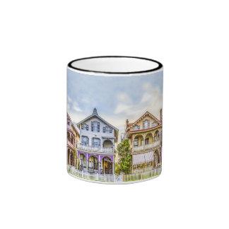 Taza de la fila de la casa del Victorian