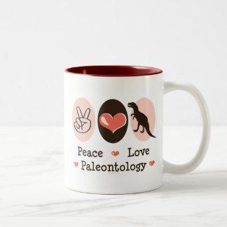 Taza de la paleontología del amor de la paz