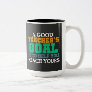 Taza de la pizarra de la meta de un buen profesor