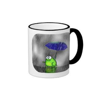 Taza de la rana del día lluvioso