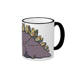 Taza de las luces de navidad del Stegosaurus