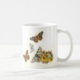 Taza de las mariposas del vintage