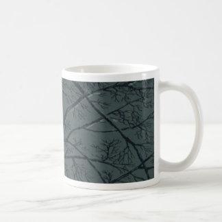 Taza de las ramas de árbol