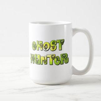 taza de los cráneos del verde caqui del fantasma