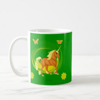 Taza de oro del unicornio de la luz del sol