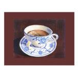 Taza de té con la bolsita de té tarjeta postal