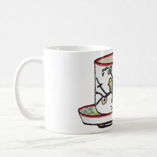 Taza de té de señora Beeton con la taza de los páj